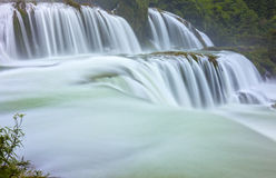Ban Gioc Waterfall. Shimmering silk sheet honoring scenic beauty of Vietnam most beautiful waterfalls. It is rugged border region had known as tourist Royalty Free Stock Images