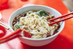 Ban Mian is a popular noodle dish. Ban Mian is a popular noodle dish, consisting of handmade noodles with flat egg served in soup or dried with vegetables stock images