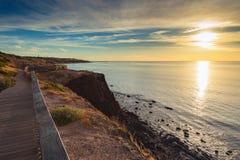 Bana längs kusten på solnedgången Fotografering för Bildbyråer