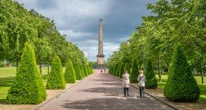Bana som leder till monumentet för Nelson ` s i Glasgow Green, Skottland Royaltyfria Foton