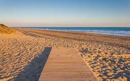 Bana till stranden Arkivfoto