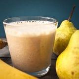 Banaan en peer smoothie royalty-vrije stock afbeeldingen