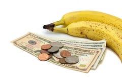 Banaan met geld stock afbeeldingen