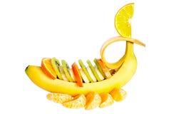 Banaan met kiwi en oranje segment. stock afbeelding