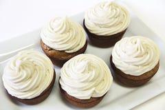 Banaanesdoorn Cupcakes op bovenkant stock afbeeldingen