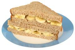 Banaansandwich in Volkorenmeel Gesneden Brood stock foto's