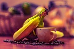 Banan, kawa, filiżanka Fotografia Stock