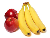 Banan med det röda äpplet som isoleras på vit arkivbilder