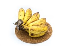 Banan med formen eller svampar på den vita bakgrunden Arkivbilder