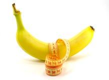 Banan och linjal Arkivfoto