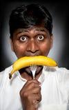 banan som äter den indiska mannen Royaltyfri Fotografi