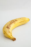 Banan z białym tłem i tekst na owoc Zdjęcie Royalty Free