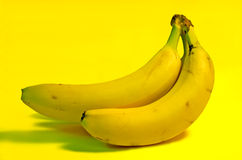Banana. S on a yellow background stock photos