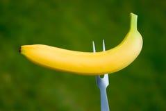 Banana. A yellow banana with fork Royalty Free Stock Photo