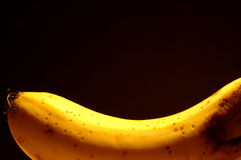 Banana. A yellow banana washed in yellowish light Stock Images