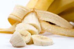 Banana affettata su bianco Immagine Stock Libera da Diritti