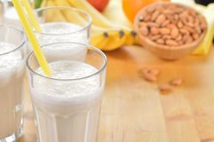 Banana and almond milk smoothie on a table. Royalty Free Stock Images