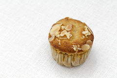 Banana almond muffin on white tablecloth Royalty Free Stock Photography