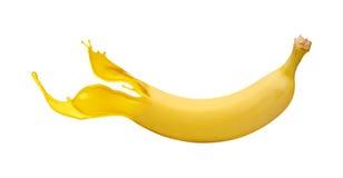 Banana amarela com respingo da pintura Fotografia de Stock Royalty Free