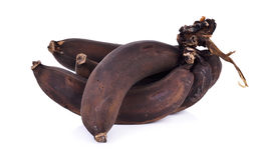 Banana appassita isolata su fondo bianco Fotografie Stock Libere da Diritti