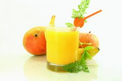 Banana apple mango carrot smoothie Stock Image