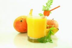 Banana apple mango carrot smoothie. In white background Stock Image