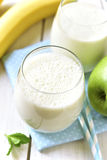 Banana apple smoothie. Stock Photos