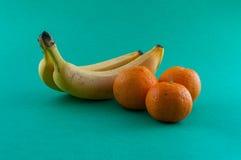 Banana, apple and tangerine.  Stock Photos