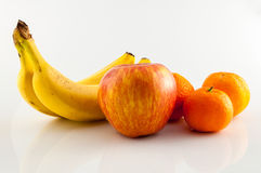 Banana, apple and tangerine. Isolated Stock Images