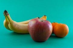 Banana, apple and tangerine. Isolated Stock Image