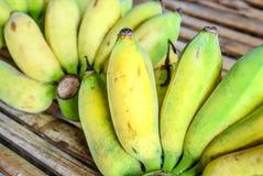Banana on bamboo floor Stock Photos