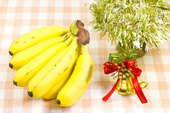 Banana and bells and Christmas tree Stock Photography