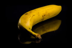 Banana on black Stock Photos