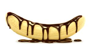 Banana in black chocolate Stock Images