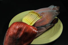 Banana Blossom on the plate. /Raw material for Thai food stock photo