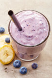 Banana and blueberry smoothie Royalty Free Stock Images