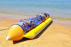 Banana boat on beach. Inflated rubber boat that can take up to ten people in one ride Royalty Free Stock Image