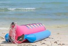 Banana boat. Colorful banana boat moored on the beach Stock Photography