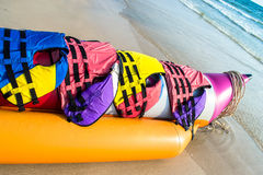 Banana boat lays on a beach Stock Photo