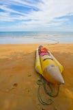 Banana boat. Lying on sandy beach royalty free stock photo