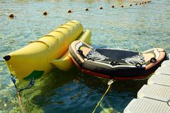 Banana boat near the pier. Summer holiday by the sea. stock photos
