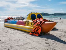 Banana Boat Not in Operational in the Beach. And life jacket around it. Beach located in Langkawi Malaysia royalty free stock image
