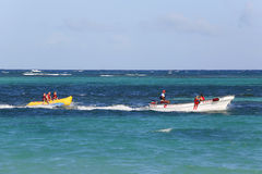 Banana boat riding at the Bavaro Beach in Punta Cana, Dominican Republic Royalty Free Stock Photos