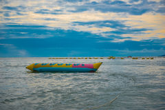 Banana boat in the sea ,Beautiful sunset and sky of the sea. Royalty Free Stock Photography