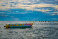 Banana boat in the sea ,Beautiful sunset and sky of the sea. Stock Photo
