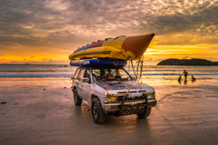 Banana boat on top of car on the beach Stock Image