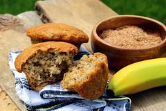 Banana bran muffins. On a wooden board outside in the sun Stock Photo