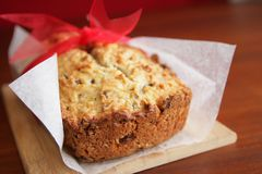 Banana bread. Fresh and warm banana bread with paper and red ribbon Royalty Free Stock Photo
