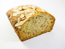 Banana Bread. A loaf of banana bread with sliced almonds stock photography