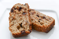 Banana bread. Slices of delicious banana bread on a white plate Royalty Free Stock Image